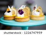 tasty little creamy cupcakes... | Shutterstock . vector #1226747959