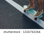 close up of a skateboarders... | Shutterstock . vector #1226762266