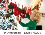 kids opening christmas presents.... | Shutterstock . vector #1226776279