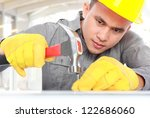 young worker put a nail use a... | Shutterstock . vector #122686060
