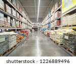 Small photo of Warehouse industrial premises for storing material. Warehouse of building materials in industiral store. Concept logistics, transport