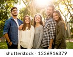 group of friends having  a... | Shutterstock . vector #1226916379