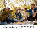 friends at the park making a... | Shutterstock . vector #1226921113