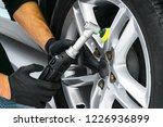 car polish wax worker hands... | Shutterstock . vector #1226936899