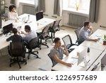 diverse multiracial staff... | Shutterstock . vector #1226957689