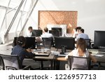 workers using computers working ... | Shutterstock . vector #1226957713