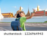 asian woman tourist with travel ... | Shutterstock . vector #1226964943