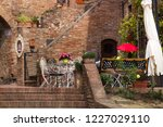 cafe. small patio. tables and... | Shutterstock . vector #1227029110