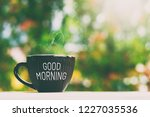 """cup of drink with text """"good... 