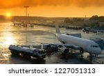 the plane at the airport is... | Shutterstock . vector #1227051313