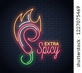 chili pepper with fire neon...   Shutterstock .eps vector #1227075469