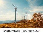 wind turbines on beautiful... | Shutterstock . vector #1227095650