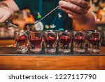 bartender is pouring tequila... | Shutterstock . vector #1227117790