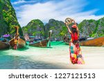 happy traveler woman on summer... | Shutterstock . vector #1227121513