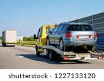 tow truck transporter carrying... | Shutterstock . vector #1227133120