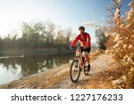 determined young man riding... | Shutterstock . vector #1227176233