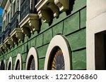 facade wall on green plastered... | Shutterstock . vector #1227206860