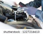 mechainc fixing a van engine | Shutterstock . vector #1227216613