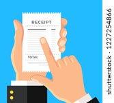 receipt. hand holding paper... | Shutterstock .eps vector #1227254866