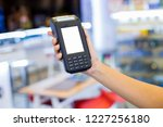 female holding gard machine in... | Shutterstock . vector #1227256180