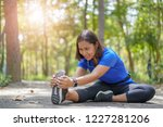 asian woman stretch muscles at... | Shutterstock . vector #1227281206