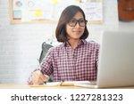 asian businesswoman reading on... | Shutterstock . vector #1227281323