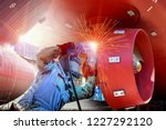 Worker Welding Process With...