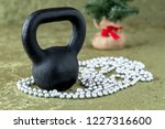 black kettlebell on a green... | Shutterstock . vector #1227316600