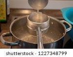 ricer for swabian spaetzle over ...   Shutterstock . vector #1227348799