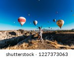couple in love among balloons.... | Shutterstock . vector #1227373063
