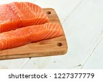 red fish on a wooden white table | Shutterstock . vector #1227377779