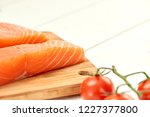 red fish on a wooden white table | Shutterstock . vector #1227377800
