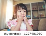 portrait of little asian girl... | Shutterstock . vector #1227401080