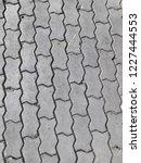 worm block footpath wallpeper   Shutterstock . vector #1227444553