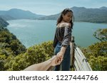 woman take her boyfriend by the ... | Shutterstock . vector #1227444766