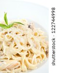 Small photo of Chicken fettuccine alfredo in a plate
