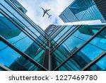 plane flying over the... | Shutterstock . vector #1227469780