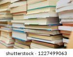 stack of books in library | Shutterstock . vector #1227499063