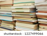 stack of books in library | Shutterstock . vector #1227499066