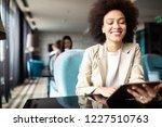 happy black businesswoman using ... | Shutterstock . vector #1227510763