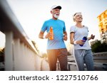 mature couple jogging and... | Shutterstock . vector #1227510766