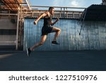 handsome young man running in... | Shutterstock . vector #1227510976