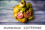 pomegranate fruit on a wooden... | Shutterstock . vector #1227555460