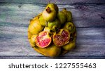 pomegranate fruit on a wooden... | Shutterstock . vector #1227555463