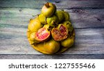 pomegranate fruit on a wooden... | Shutterstock . vector #1227555466