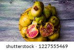 pomegranate fruit on a wooden... | Shutterstock . vector #1227555469