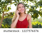 young blonde girl keeping a... | Shutterstock . vector #1227576376