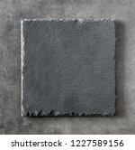 black square stone plate on... | Shutterstock . vector #1227589156