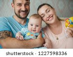 portrait of happy young parents ... | Shutterstock . vector #1227598336