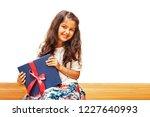 cute indian little girl holding ...   Shutterstock . vector #1227640993